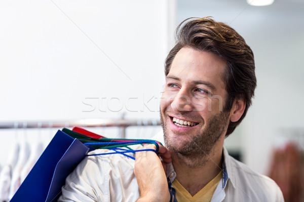 Sonriendo hombre ropa tienda compras Foto stock © wavebreak_media