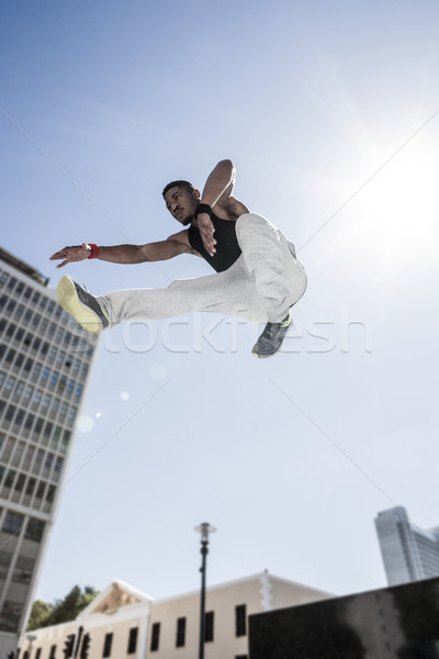 Extreme athlete jumping in front of building Stock photo © wavebreak_media