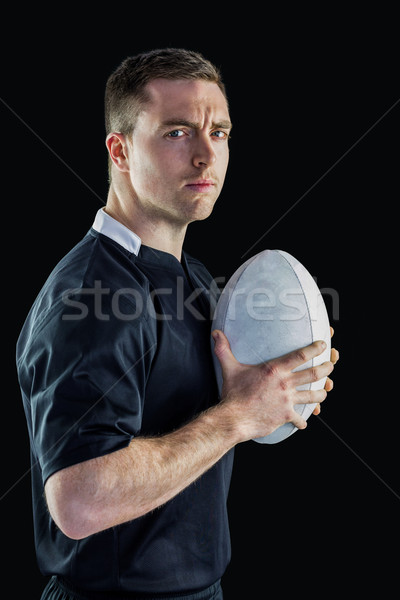 Rugby player holding a rugby ball Stock photo © wavebreak_media