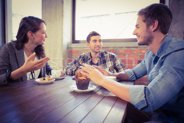 Smiling friends talking and enjoying coffee Stock photo © wavebreak_media