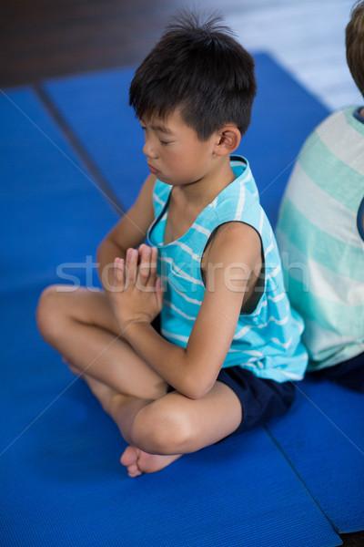 Siblings performing yoga at home Stock photo © wavebreak_media