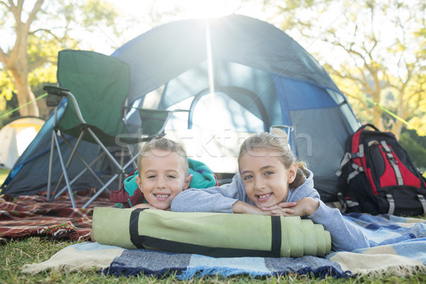 Smiling siblings lying outside the tent Stock photo © wavebreak_media