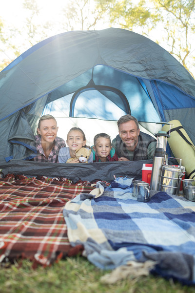 Smiling family lying in the tent Stock photo © wavebreak_media