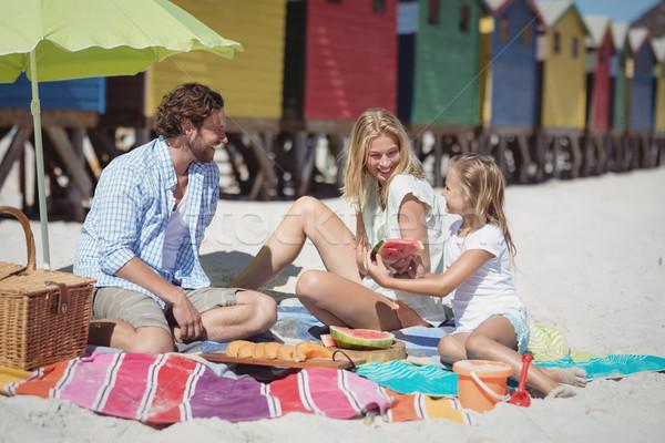 Família feliz sessão juntos cobertor praia Foto stock © wavebreak_media