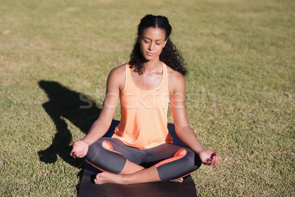 Mulher lótus posição mulher jovem feliz Foto stock © wavebreak_media