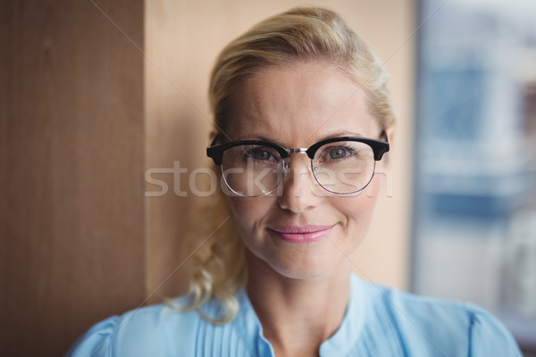 Portrait of smiling executive wearing spectacles Stock photo © wavebreak_media