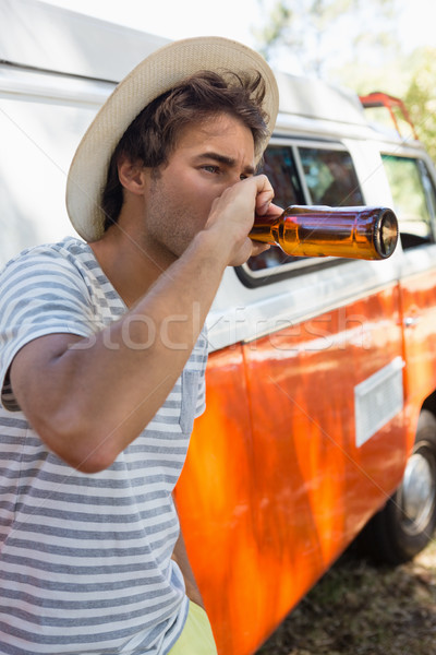 Man drinken bier fles park jonge man Stockfoto © wavebreak_media