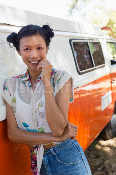 Woman leaning on camper van in the park Stock photo © wavebreak_media