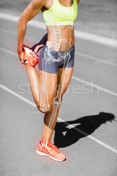 Low section of sportswoman stretching leg on track Stock photo © wavebreak_media
