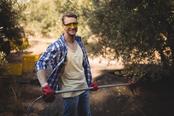 Sorridente homem ancinho oliva fazenda Foto stock © wavebreak_media