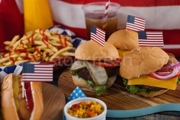 Hot dog and hamburgers decorated with 4th july theme Stock photo © wavebreak_media