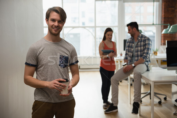 портрет исполнительного чашку кофе коллега Сток-фото © wavebreak_media