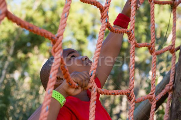 Fiú mászik net akadályfutás képzés csizma Stock fotó © wavebreak_media