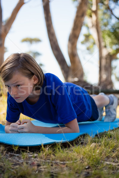 Girl exercising on exercise mat during obstacle course training Stock photo © wavebreak_media