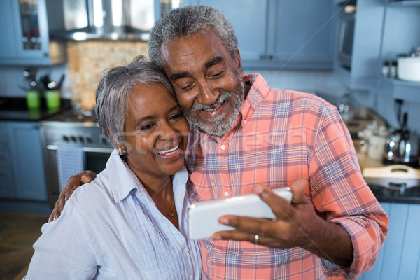 Smiling couple taking selfie at home Stock photo © wavebreak_media
