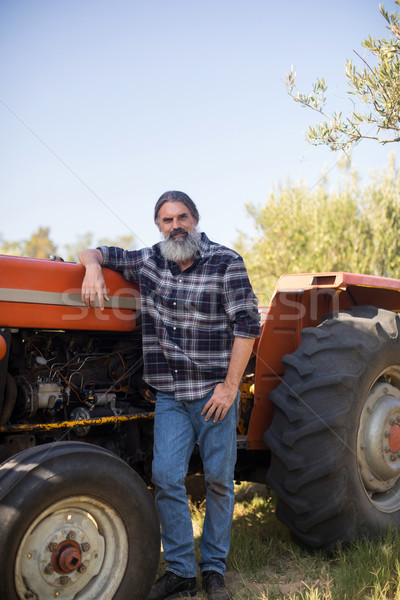 Portrait of confident man leaning on tractor Stock photo © wavebreak_media