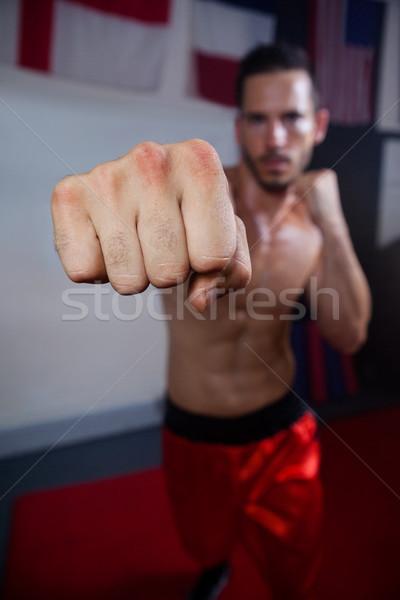 Man practicing boxing in fitness studio Stock photo © wavebreak_media