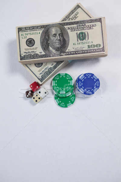 US dollars, dice and casino chips on white background Stock photo © wavebreak_media