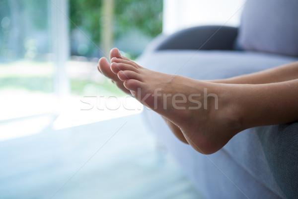 Düşük bölüm kız rahatlatıcı kanepe ev Stok fotoğraf © wavebreak_media