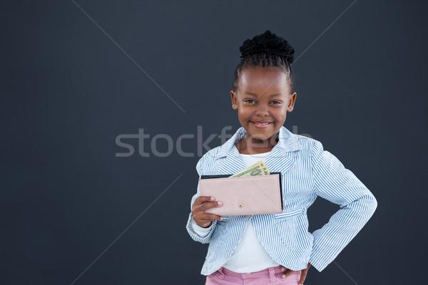портрет улыбаясь деловая женщина валюта кошелька Сток-фото © wavebreak_media