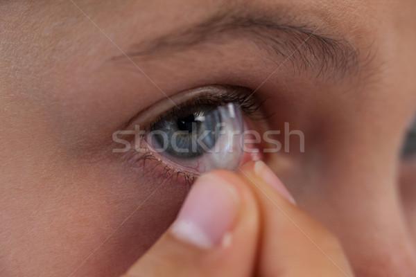 Lány visel lencsék fehér közelkép kommunikáció Stock fotó © wavebreak_media
