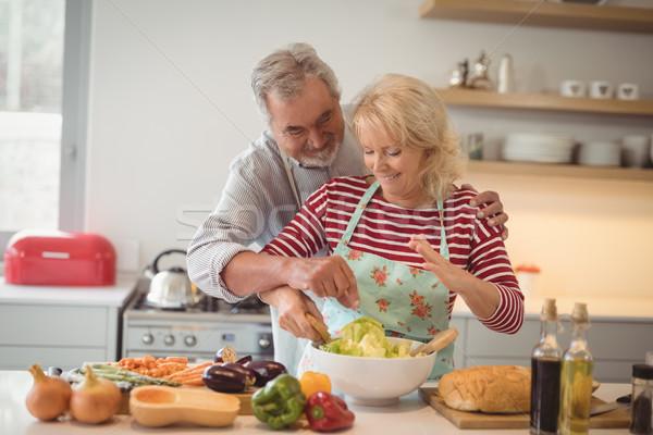 Senior couple mixing vegetables salad in bowl Stock photo © wavebreak_media