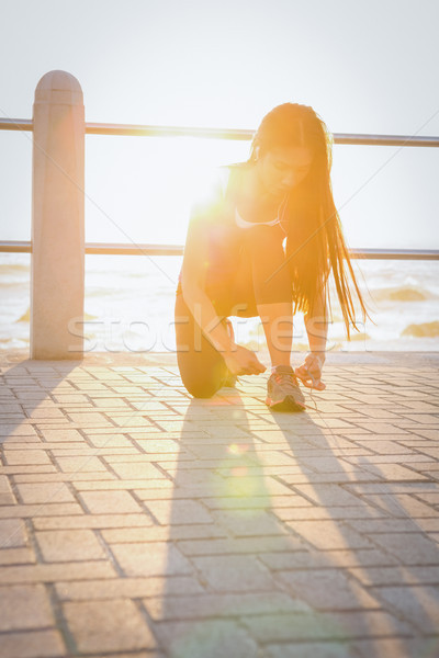 Fit woman tying her shoelace at promenade Stock photo © wavebreak_media