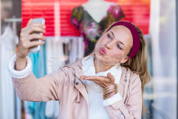 Woman blowing kiss and taking selfies  Stock photo © wavebreak_media