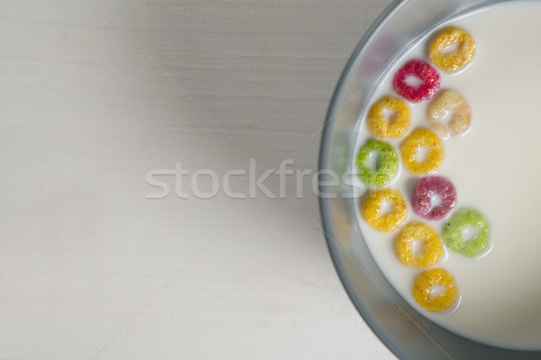 Tazón leche cereales anillos blanco libro Foto stock © wavebreak_media