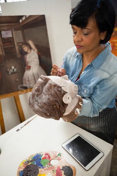 Woman painting a sculptor Stock photo © wavebreak_media