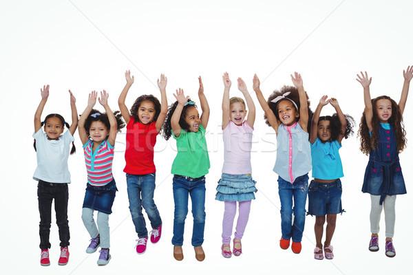Vonal lányok áll karok a magasban fehér boldog Stock fotó © wavebreak_media