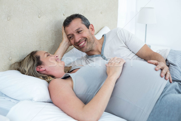 Expecting couple lying on bed and chatting Stock photo © wavebreak_media