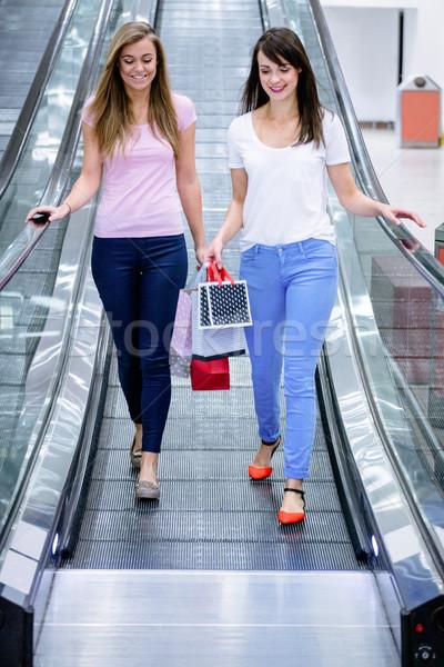 Dois belo mulheres escada rolante Foto stock © wavebreak_media