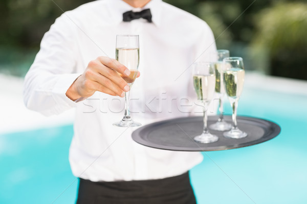 Midsection of waiter offering champagne Stock photo © wavebreak_media