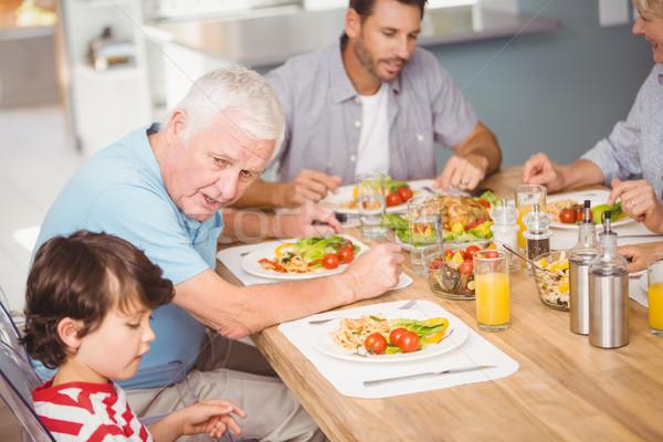 Dziadek wnuk śniadanie domu domu człowiek Zdjęcia stock © wavebreak_media
