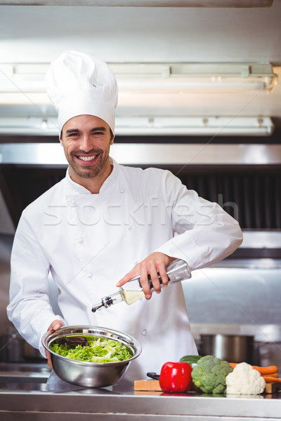 Chef putting oil on salad Stock photo © wavebreak_media