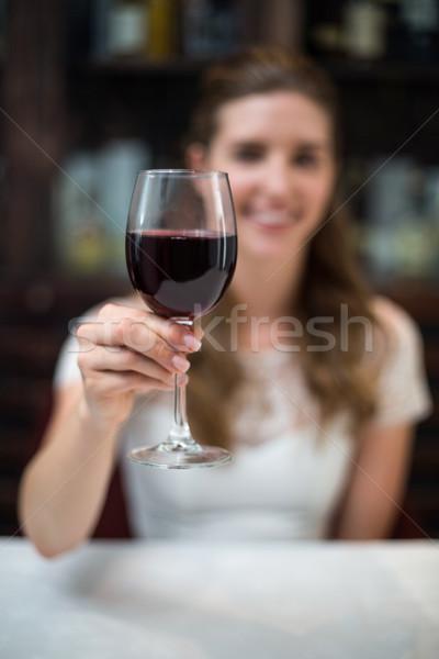 Happy woman holding wine glass Stock photo © wavebreak_media