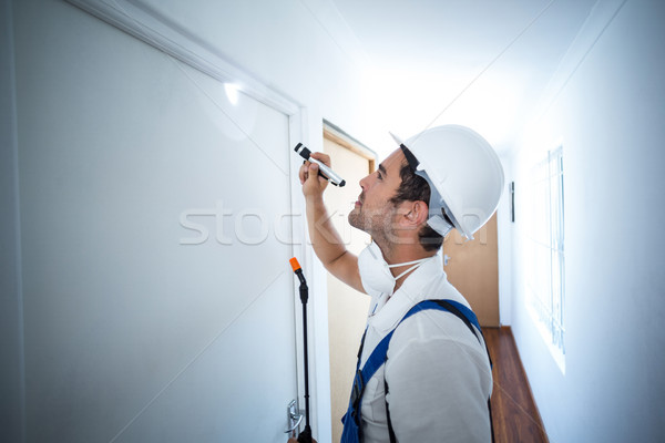 Side view of worker using flashlight in hallway Stock photo © wavebreak_media