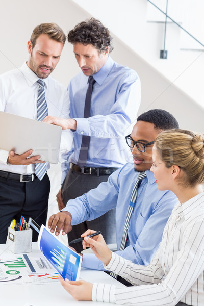 Business colleagues reviewing a report at desk Stock photo © wavebreak_media