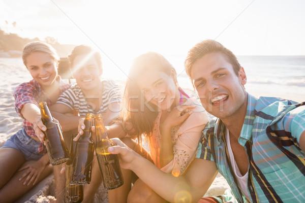 Smiling friends with beer Stock photo © wavebreak_media