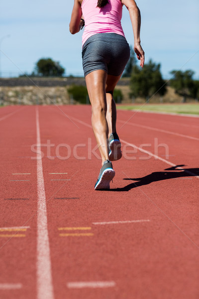 Rear view of female athlete running on the running track Stock photo © wavebreak_media