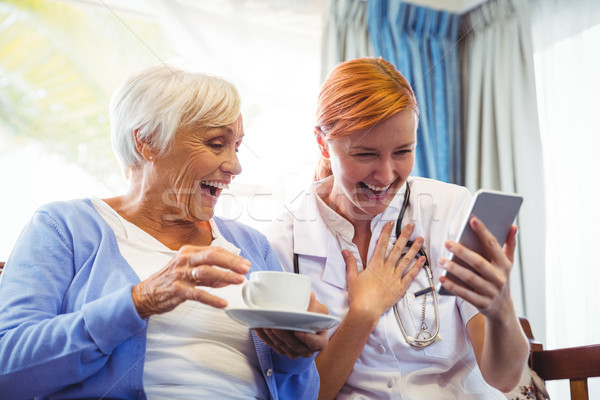 Senior woman and nurse using digital tablet Stock photo © wavebreak_media