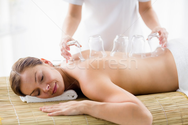 Masseur giving suction massage to woman Stock photo © wavebreak_media