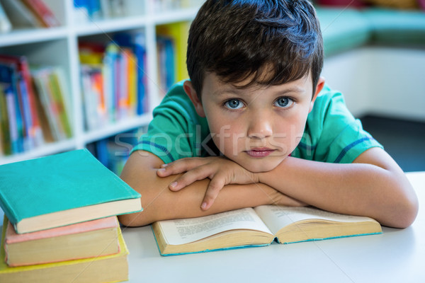 Elementary boy with book in school library Stock photo © wavebreak_media