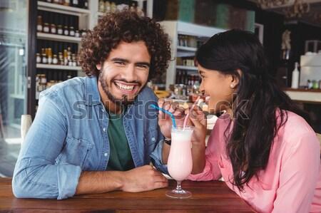 Happy couple drinking milkshake Stock photo © wavebreak_media