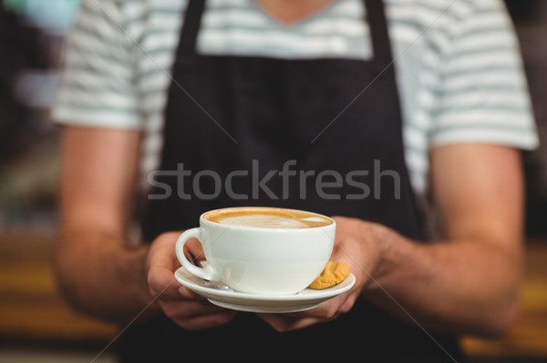 Mid section of waiter offering a cup of coffee Stock photo © wavebreak_media