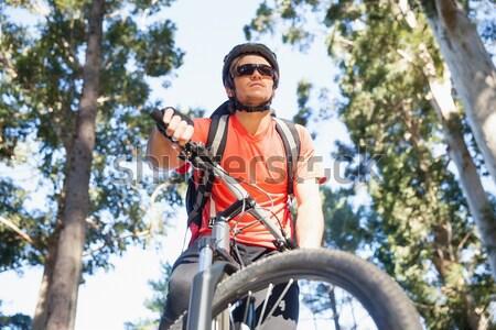 Kobiet stałego rowerów górskich lasu portret Zdjęcia stock © wavebreak_media