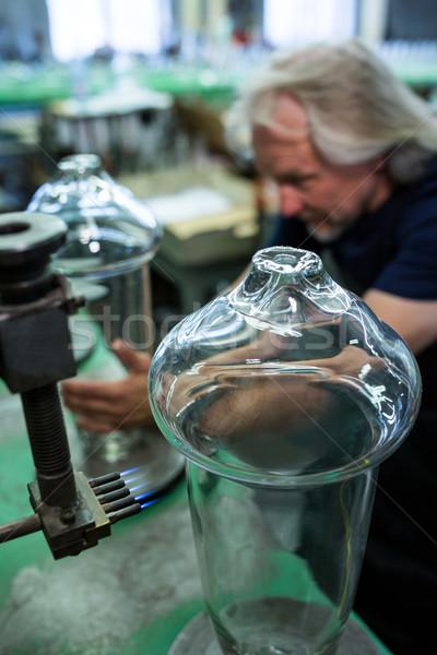 Glassblower working on a glass Stock photo © wavebreak_media