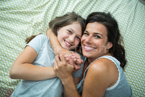 Mother and daughter playing on bed at home Stock photo © wavebreak_media
