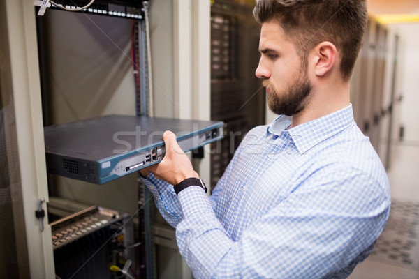 Technician removing server from rack mounted server Stock photo © wavebreak_media